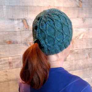 Trellis Ponytail Hat Pattern  Paid   The trellis knit pattern give it  texture d6b23a3a7e1